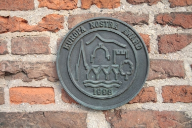 Europa Nostra Award aan de Koppelpoort in Amersfoort. JohnBoers via Wikimedia Commons, CC BY-SA 3.0 NL